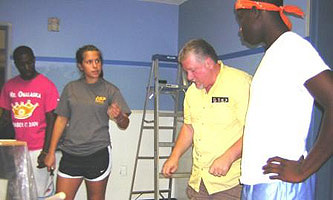 Mark Bertrang working with youth during his youth mission trip to West Virginia.